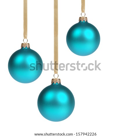 three blue christmas balls hanging on ribbon, isolated on white - stock photo