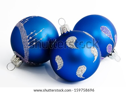 Three blue christmas balls isolated on a white background  - stock photo