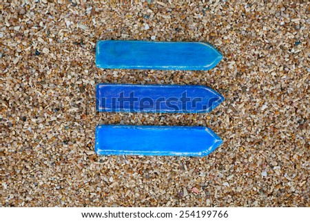 Three blue empty wooden arrows on the coral beach in Thailand. Horizontal. Top view. Space for text. - stock photo