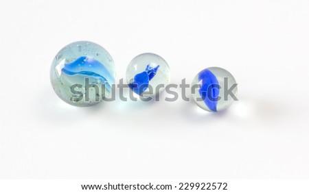 Three Blue Marbles - stock photo