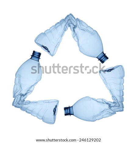 three blue plastic bottles forming the symbol of recycling - stock photo