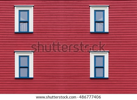 Three blue windows on red building