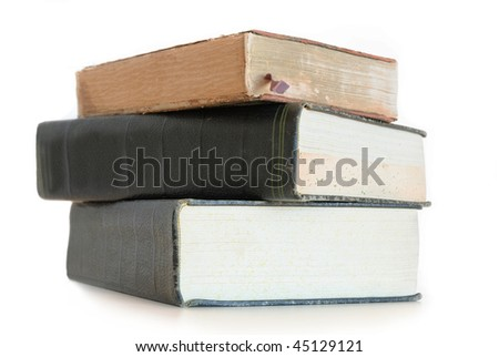Three books lying down isolated on white background. - stock photo