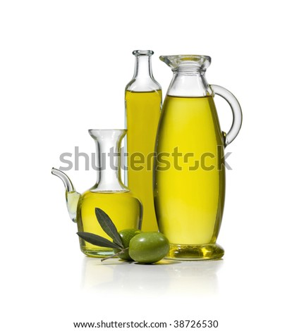 Three bottles of olive oil with two olives on white background - stock photo