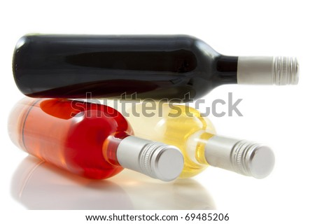 Three bottles of wine isolated over white - stock photo