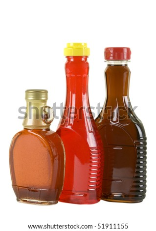 Three bottles with strawberry and maple syrup; isolated, two clipping paths included - stock photo