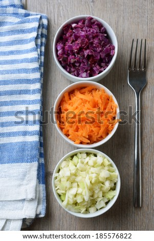 three bowls of fresh raw vegetable salad
