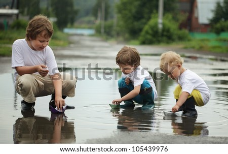 three boy play in water - stock photo