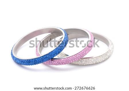 three bracelets on a white background - stock photo