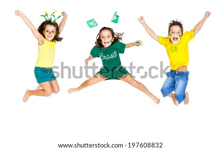 three Brazilian fans Kids jumping and supporting Brazil for popular sports competitions, like soccer, volleyball and olympics. - stock photo