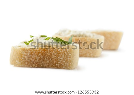 Three bread slices topped with herb butter