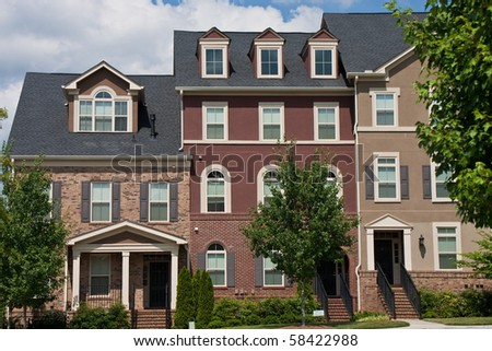 Three brick rowhouses after new cosntruction - stock photo