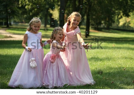 Three bridesmaids with bubble - stock photo