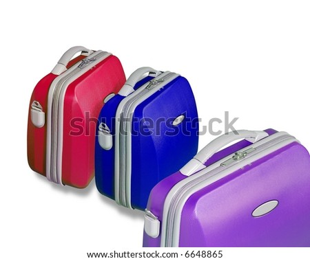 Three bright colored suitcase isolated on a white background with clipping path - stock photo