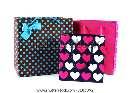 Three bright gift bags isolated on white