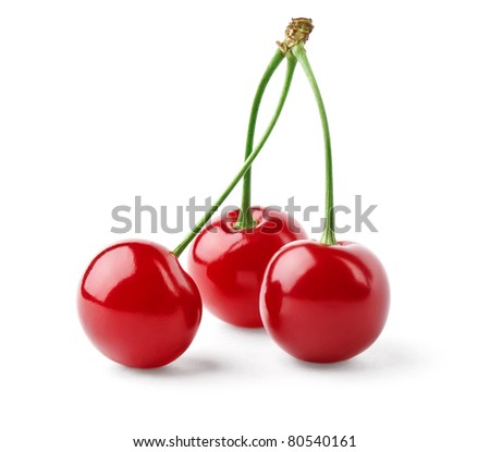 Three bright red cherries isolated on white background