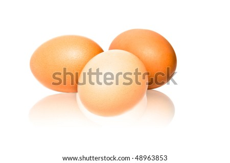 Three brown eggs isolated on a white background.