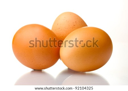 three brown eggs isolated on white - stock photo