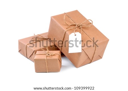 Three brown packages on white - stock photo
