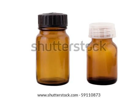three brown small bottles on white background - stock photo