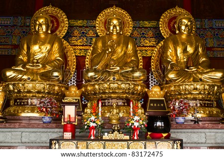 Three Buddhas in the Chinese temple of Thailand - stock photo