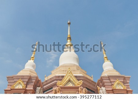 Three Buddhist style pagoda under blue sky - stock photo