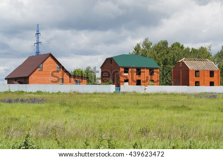 Three built cottage.Shooting in the Moscow region. - stock photo