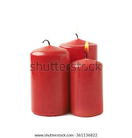 Three burning red candles isolated - stock photo