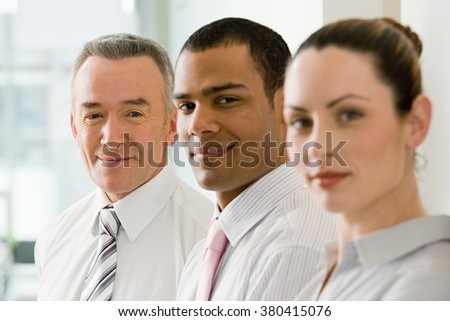 Three business colleagues in a row