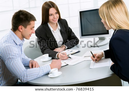 Three business colleagues working together - stock photo