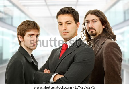 three business men at the office - stock photo