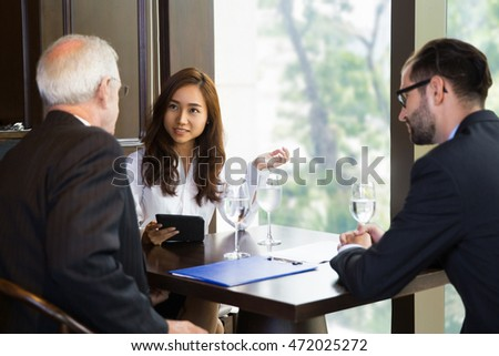 Three Business People Communicating