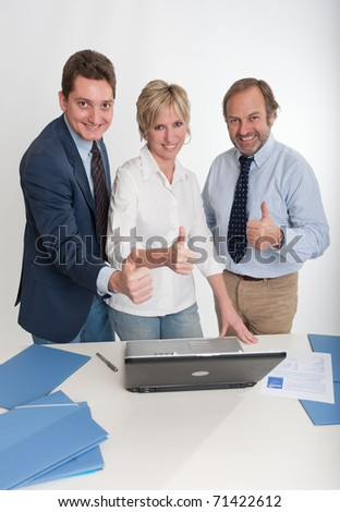 Three business people doing the ok sign - stock photo