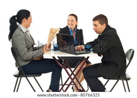 Three business people sitting on chairs in a cafe shop searching on laptop,reading newspaper and having conversation against white background