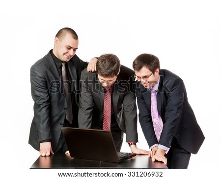 Three business people standing around the table near laptop and conduct business talk isolated on white background