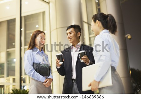 three business people talking outside the office - stock photo
