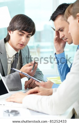 Three business people thinking together over a task