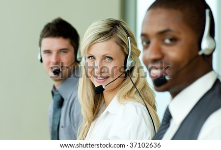 Three business people working in the office with headsets