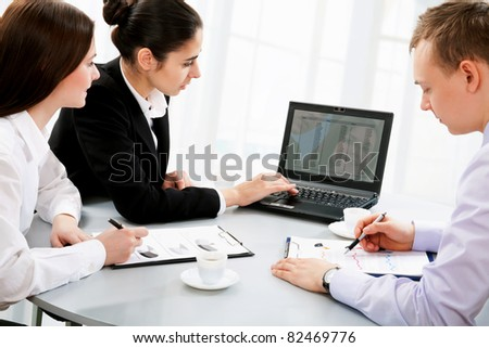 Three business people working together at office - stock photo
