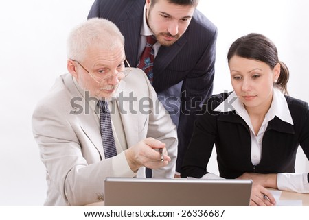 Three  business people working with lap-top - stock photo