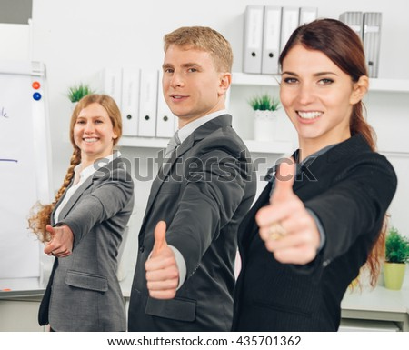 three business person standing in line an shows thumb up