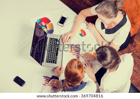 Three business woman investment consultant analyzing company annual financial report balance sheet statement working with documents graphs. Stock market, office, tax, concept. Hands with charts papers - stock photo