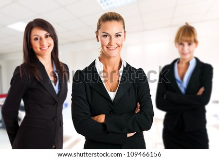 Three business women in an office - stock photo
