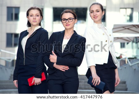 Three business women. Teamwork. Businesswomen discussing. Group of business people. Business woman group. - stock photo