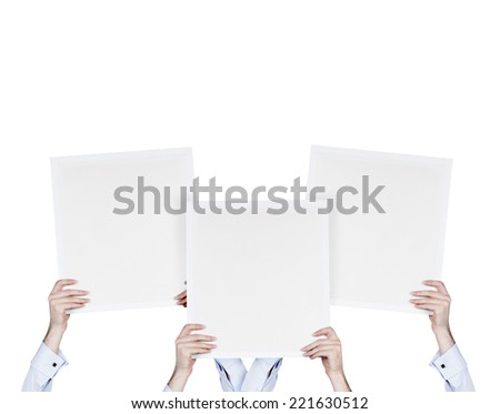 three businessman holding three blank posters. Isolated on white background. - stock photo