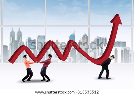 Three businessmen carrying a business growth chart in the office - stock photo