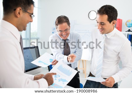Three businessmen discussing strategy of the company - stock photo