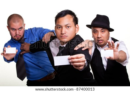 Three businessmen fighting to give their presentation card f - stock photo