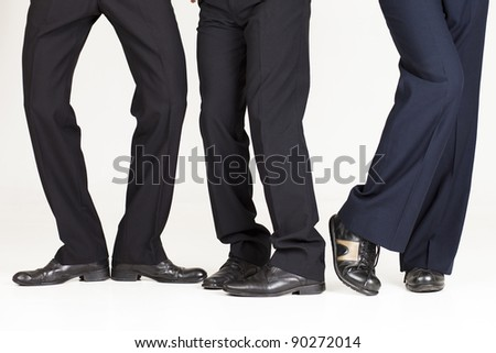 Three businessmen legs over white background doing funny poses.