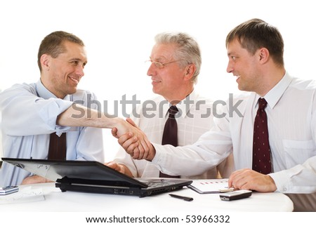 Three businessmen on a white